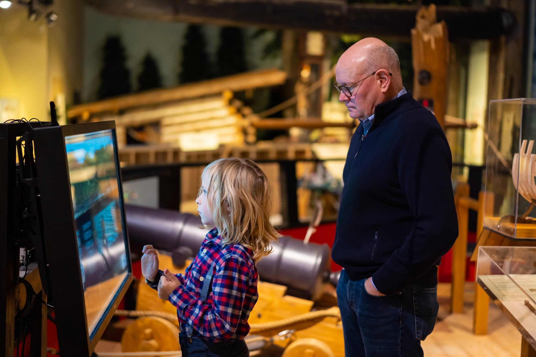 Photo of man and boy with interactive game