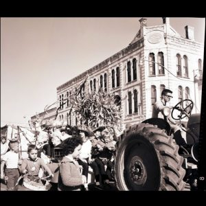 Kids with a tractor in a parade