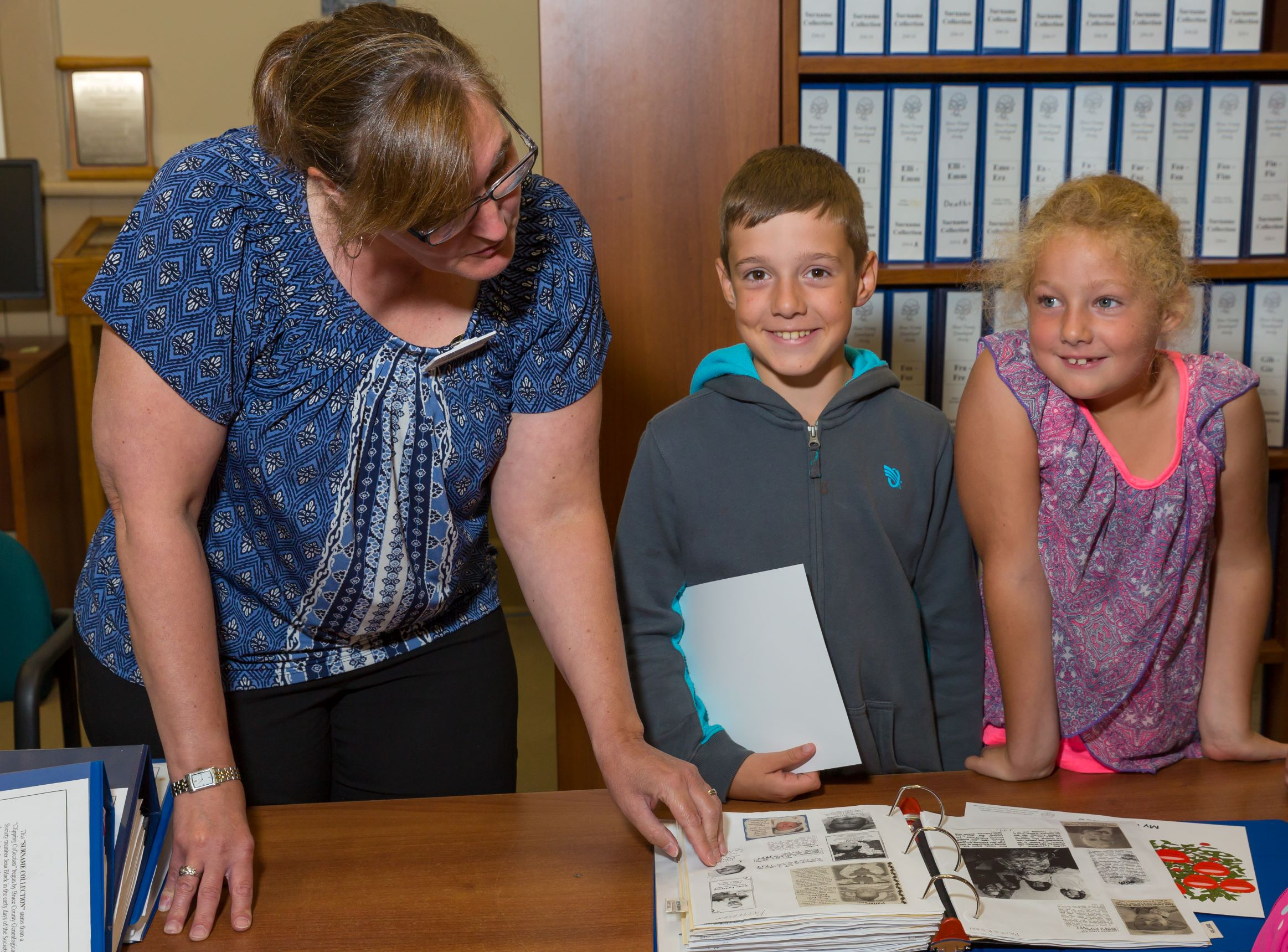 Photo of children being shown family history