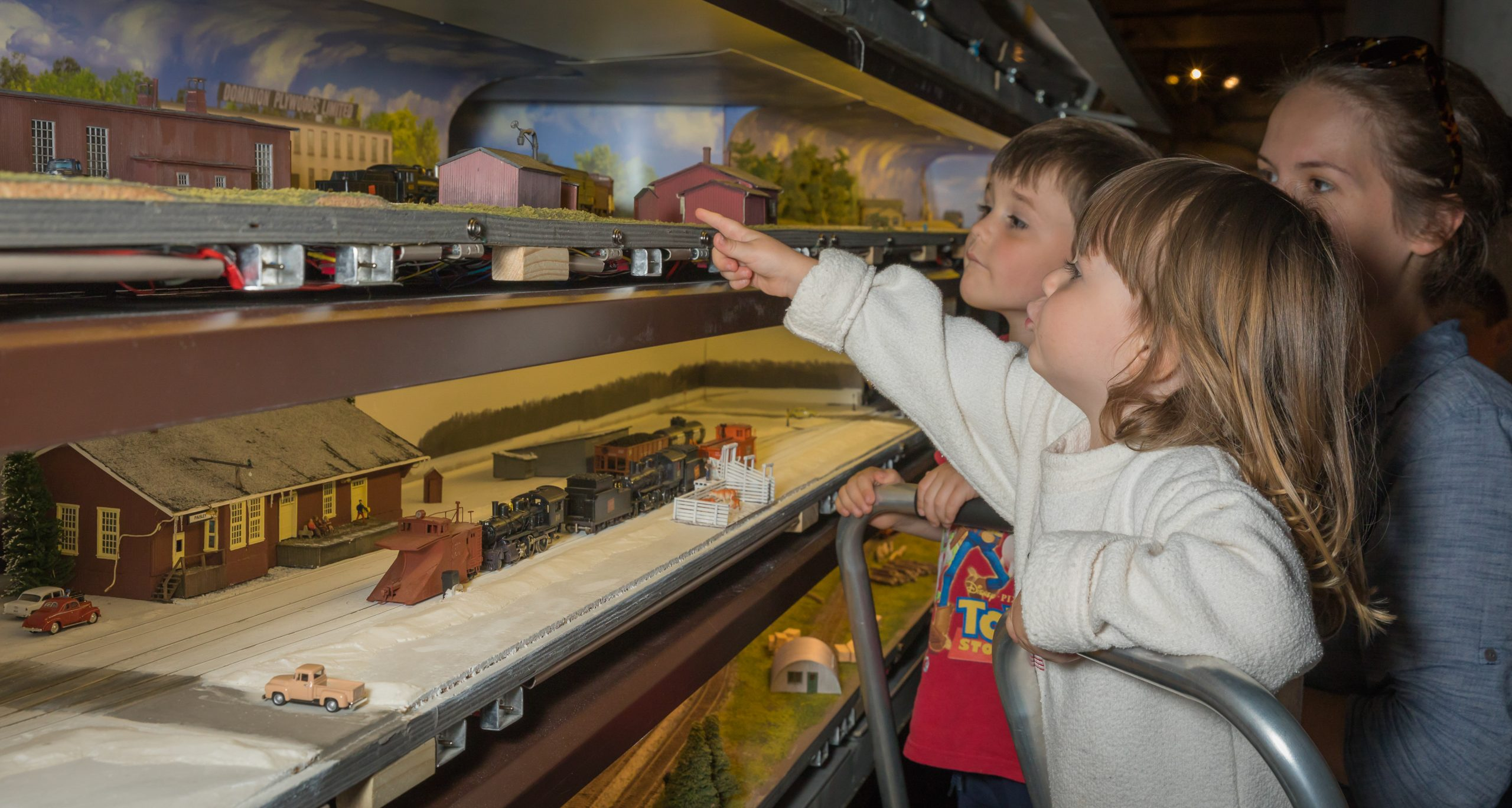 image of children playing with trains exhibit