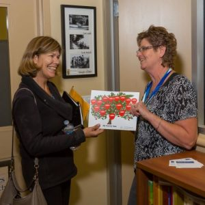 photo of staff member providing a family tree to a patron
