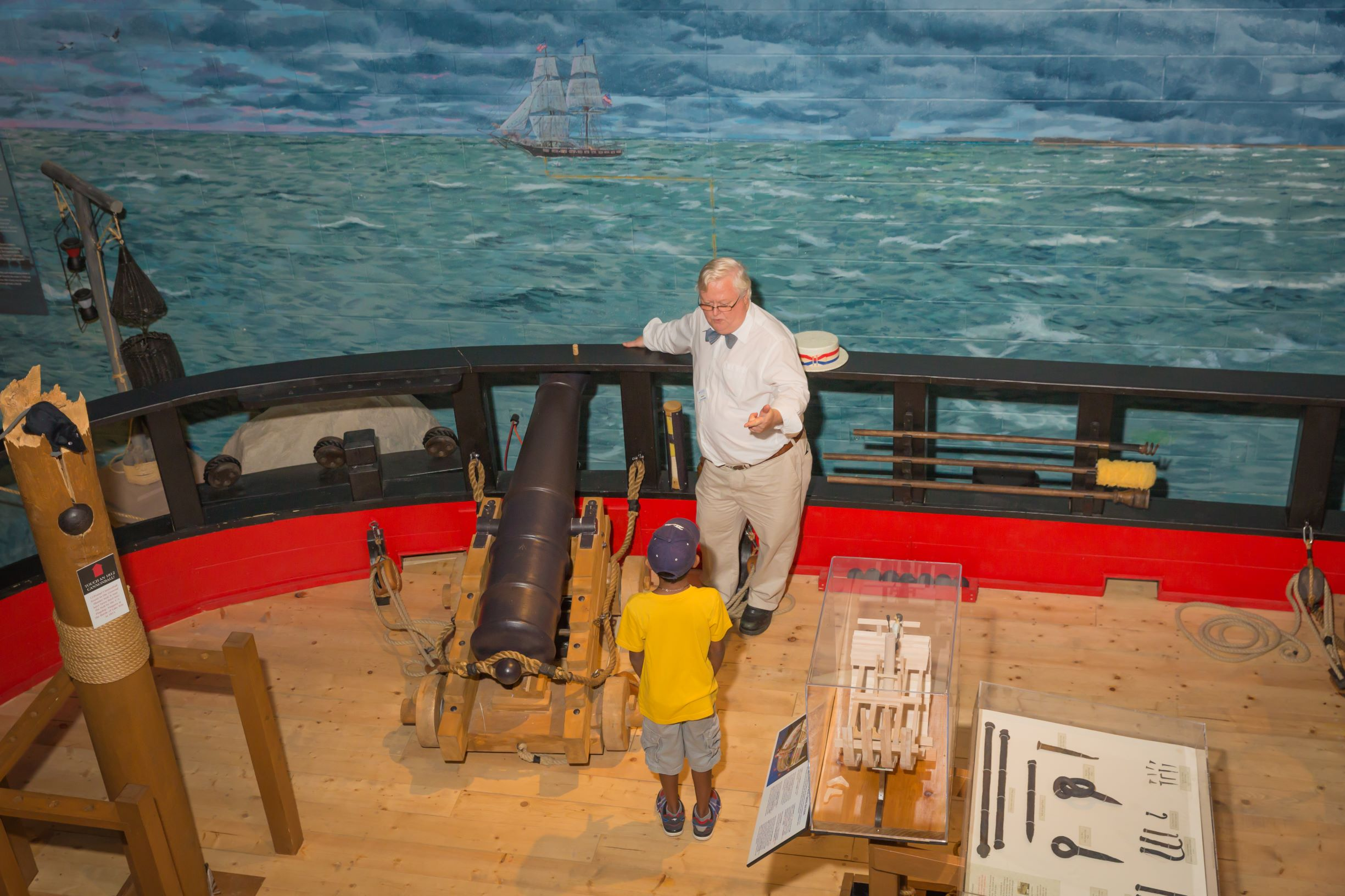 photo of man with small child on HMS General Hunter replica boat