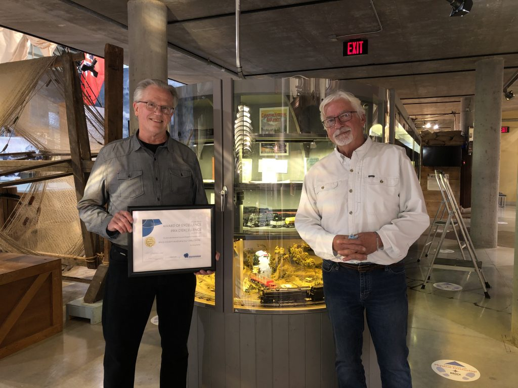 photo of exhibit designer and volunteer with the honourable mention award from the Ontario Museum Association award