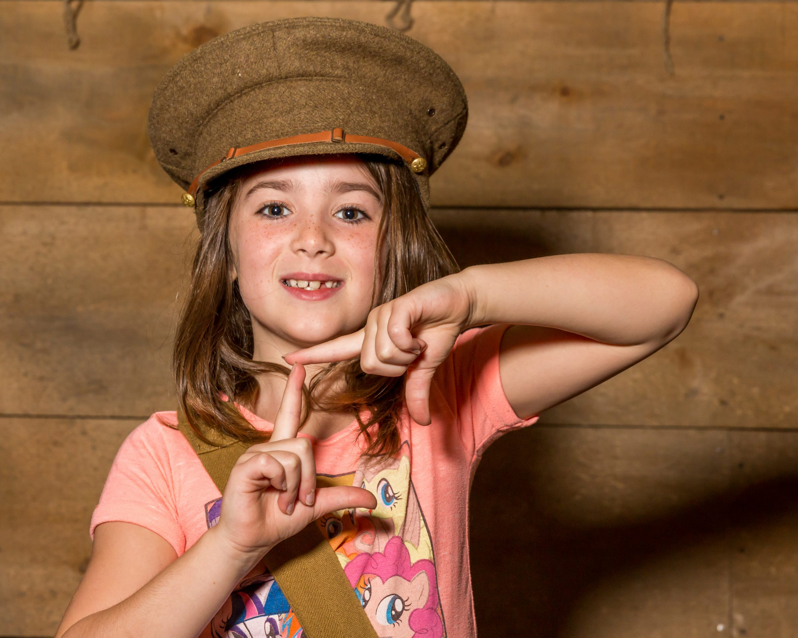 Image of girl dressed in soldiers hat