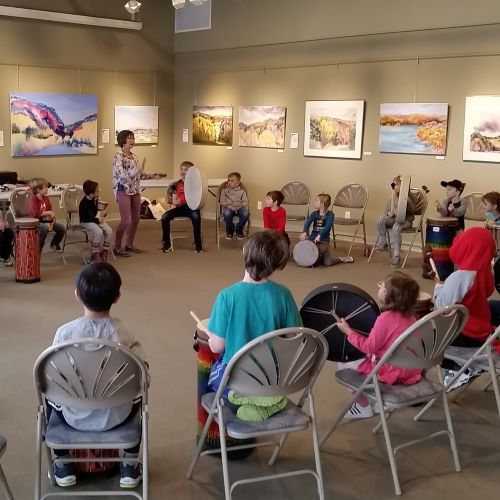 photo of kidzone campers participating in a drum cirlce