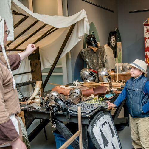 photo of child talking with medieval armour presenter