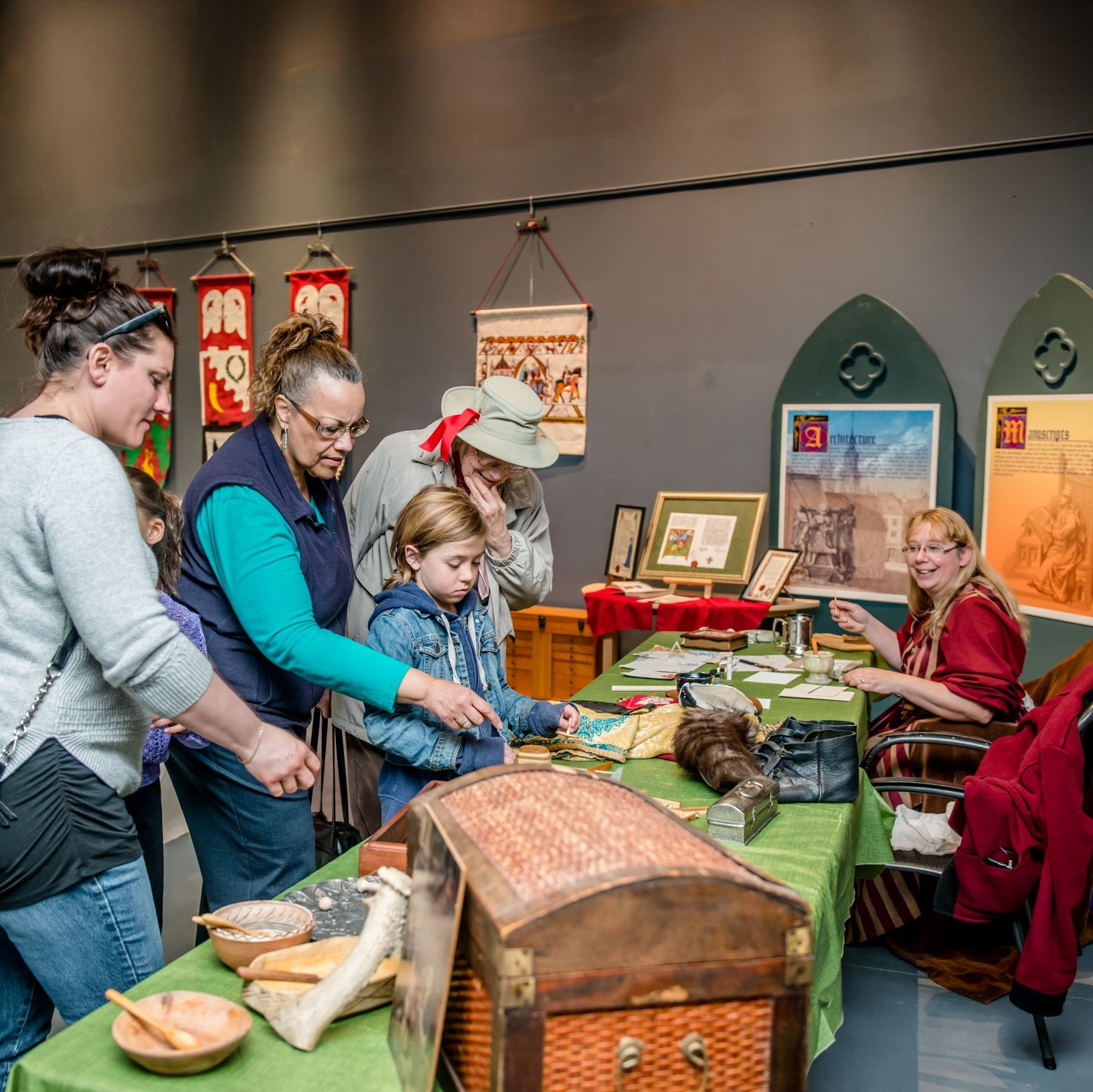 photo of people looking at medieval domestic items
