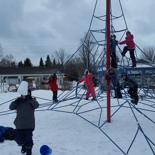 photo of kidzone campers playing in the snow