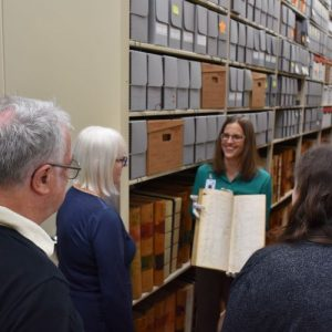 Photo of archivist providing a tour of the stacks