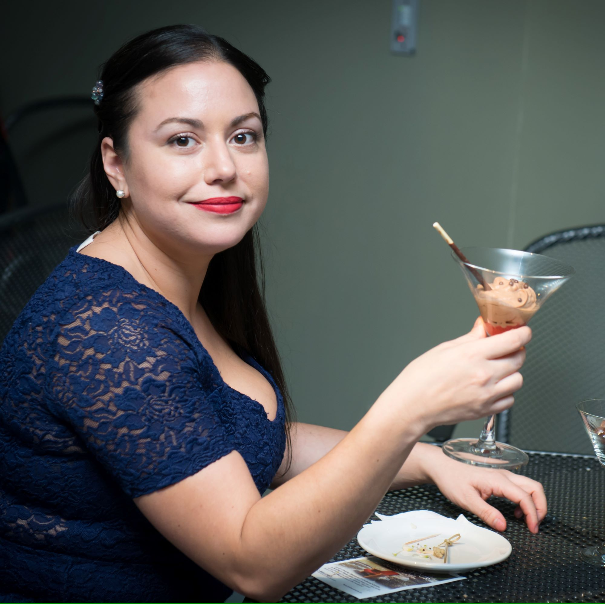 photo of woman and drink at event