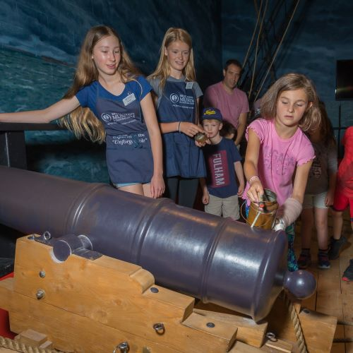 photo of youth volunteers preparing to launch the cannon