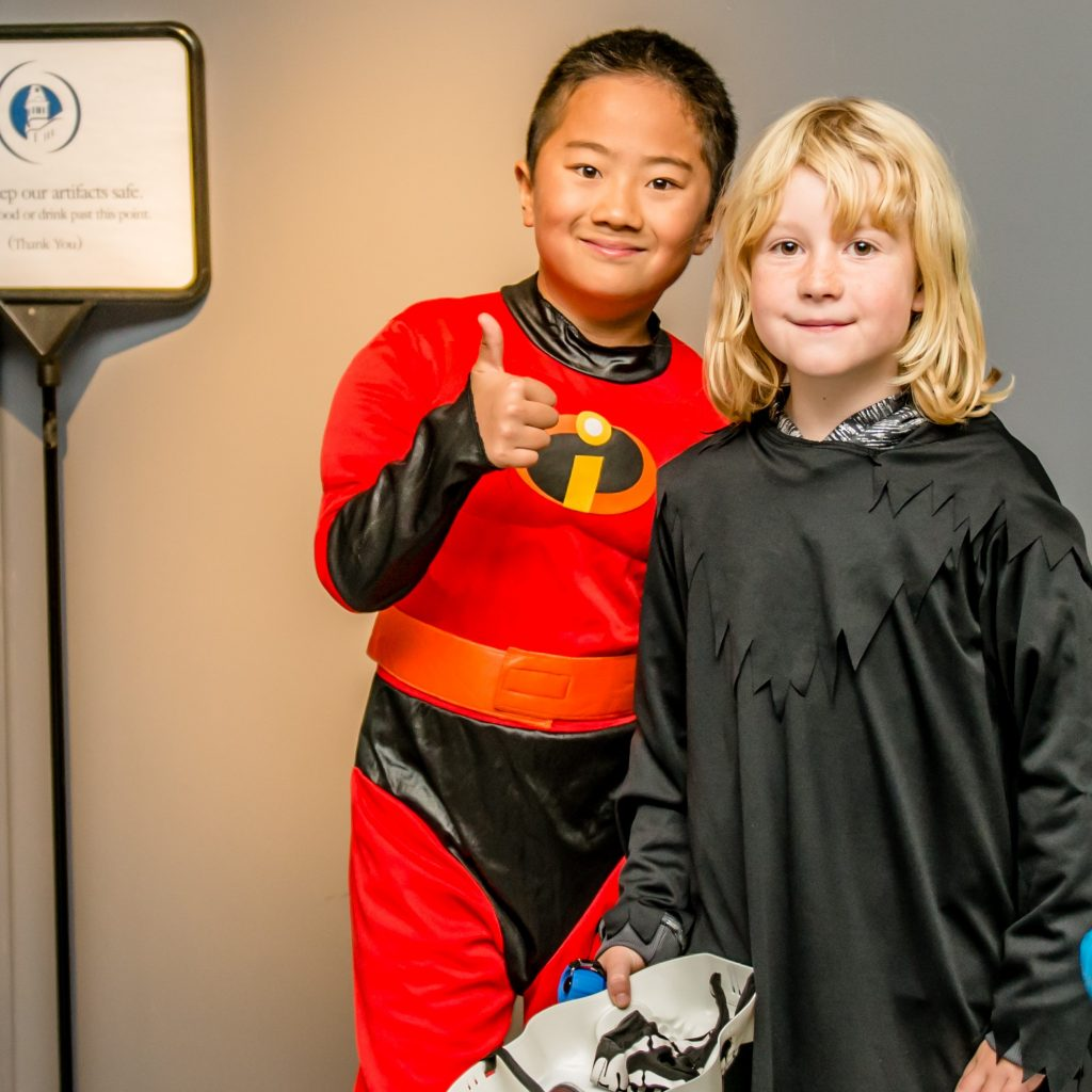 photo of two kids dressed up for halloween