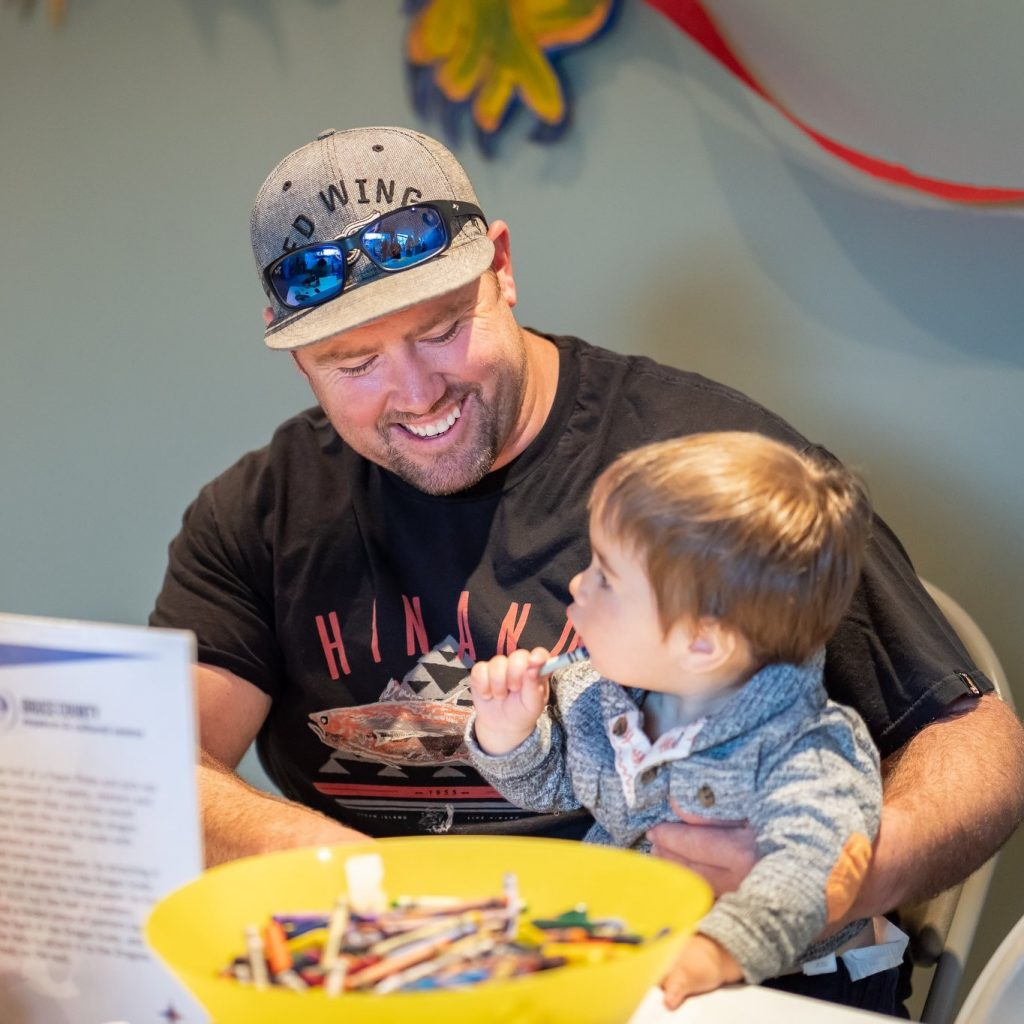 photo of man and child with activity station
