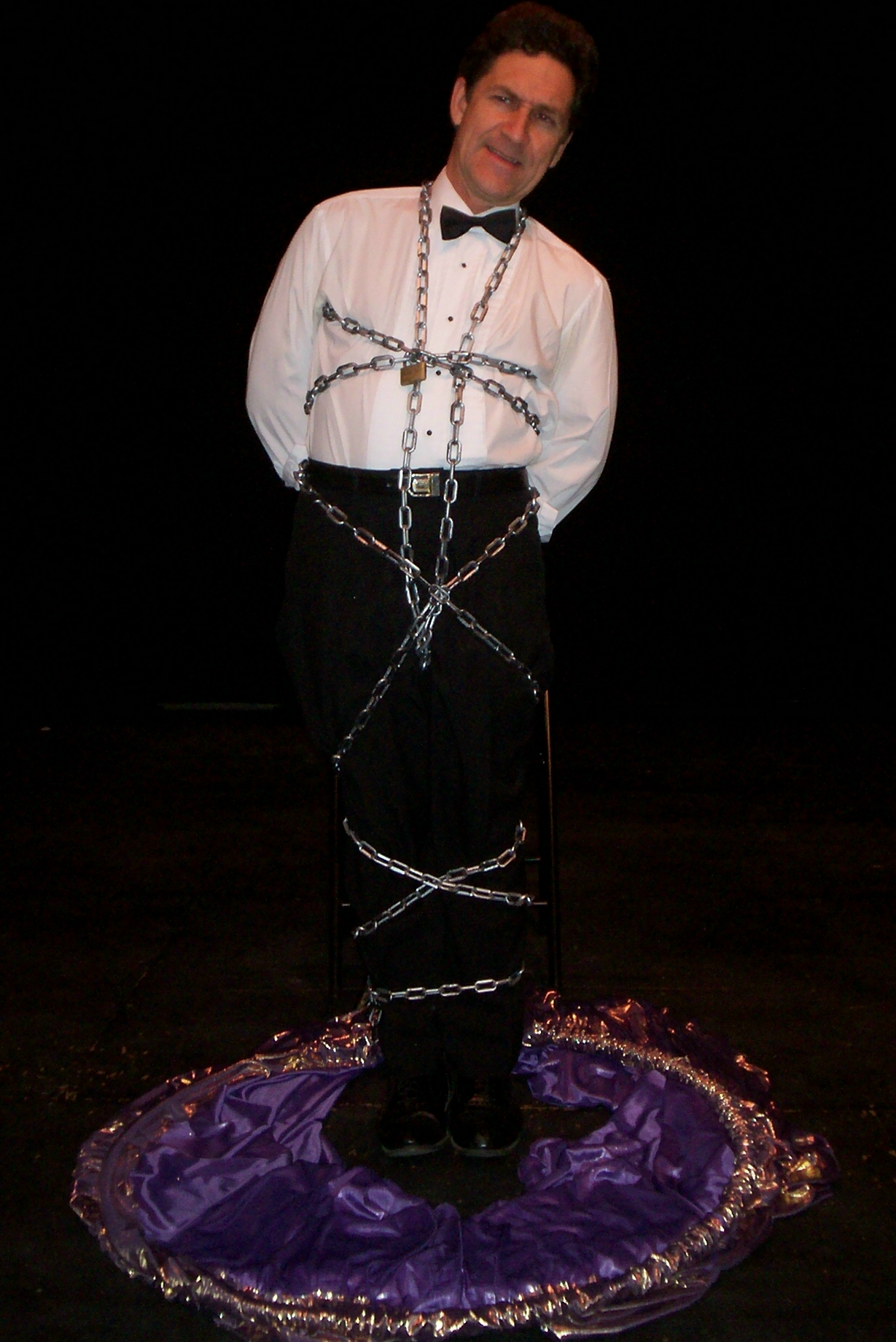 photo of magician wrapped in chains