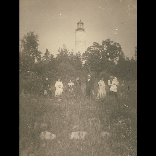 People in Front of Chantry Island Lighthouse