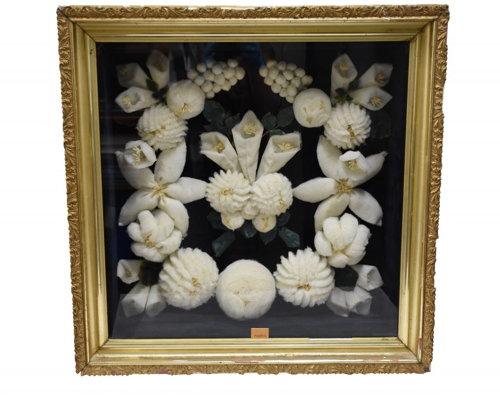 Image of a shadow box with a handmade wreath
