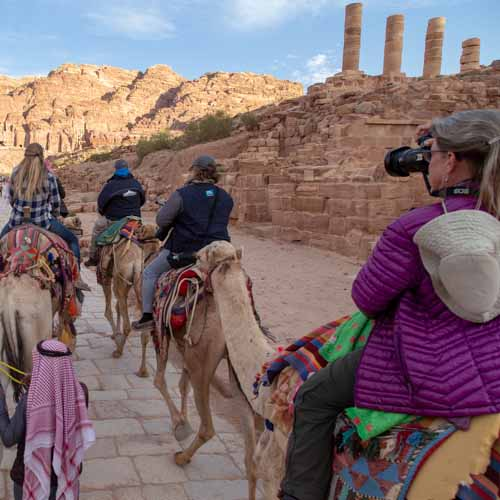 Photo of photographer on a camel taking a photo