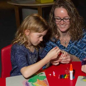 Photo of mother and daughter making a craft