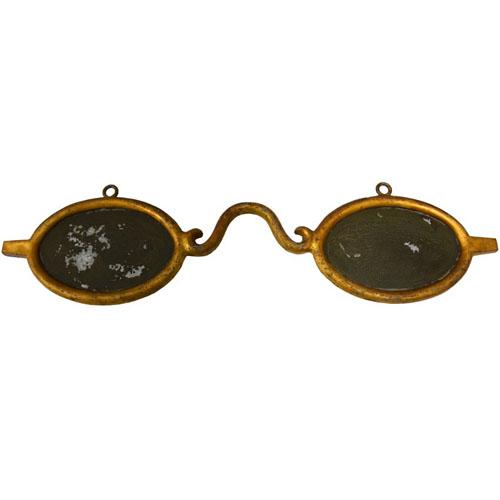 Sign of Isaiah Shoemaker in shape of eyeglasses