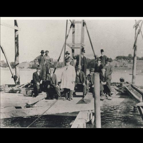 Men building bridge