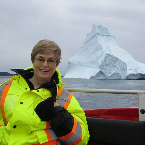 photo of adventurer Joanne in front of an ice burg