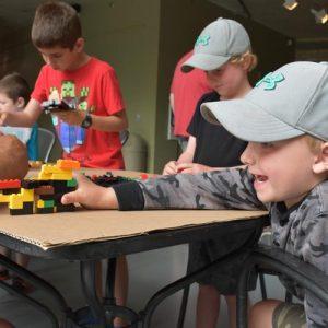 Image of boy with lego
