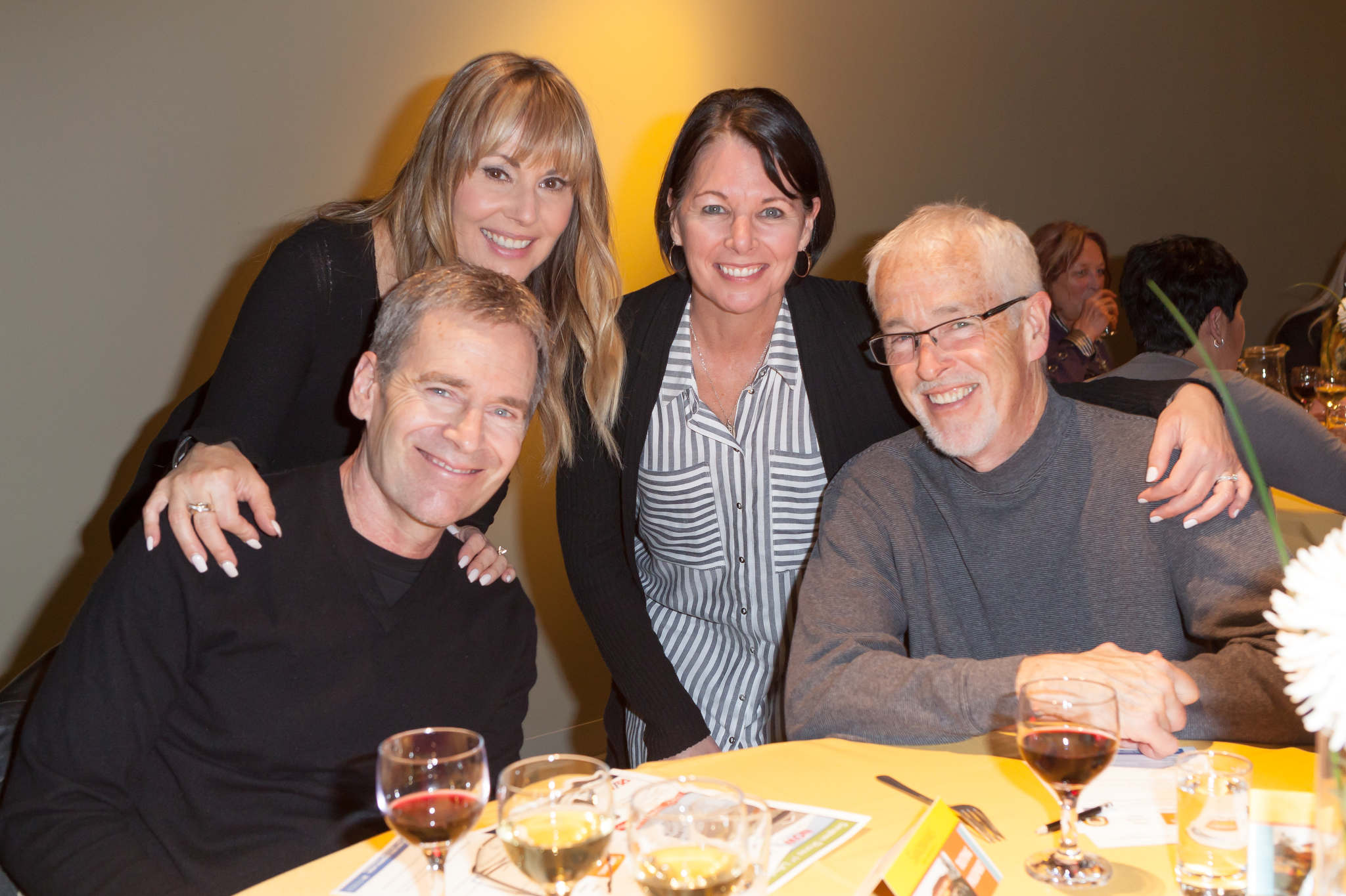 Image of two women and two men at a wine tasting