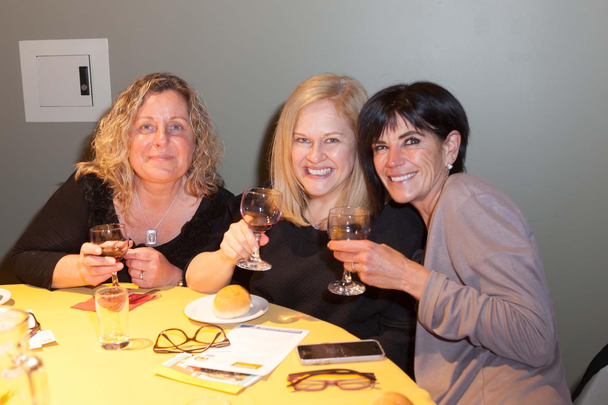 image of three women at a wine tasting
